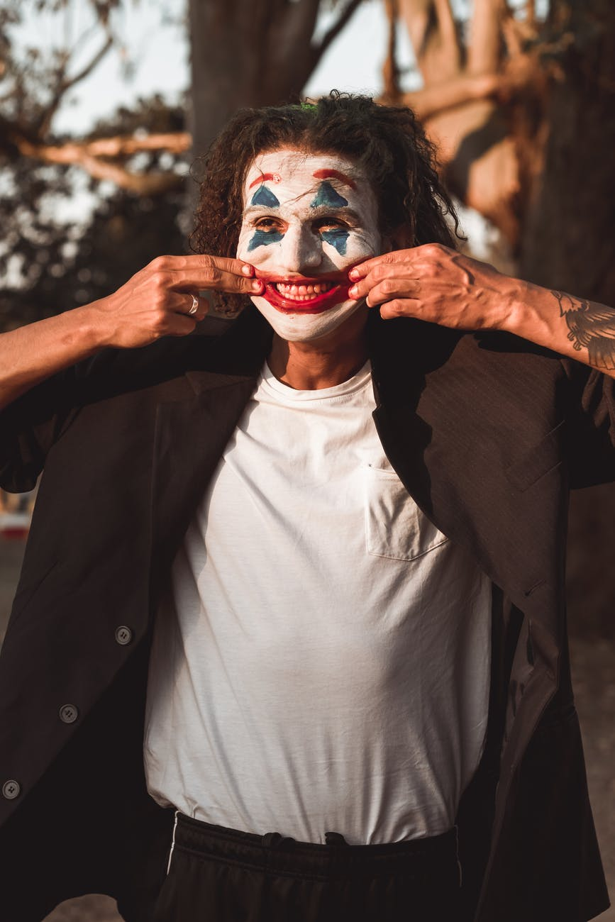 clown stretching his mouth